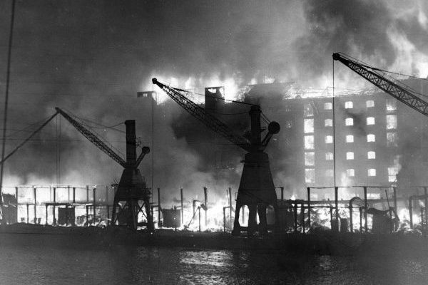 Warehouses ablaze (the left wing of the No.8 warehouse) following the heavy enemy bombing raids on the Surrey Commercial Docks in Rotherhithe. This raid took place on the 7th September and this was consider to be the start of the Blitz upon London and followed by other important UK cities
